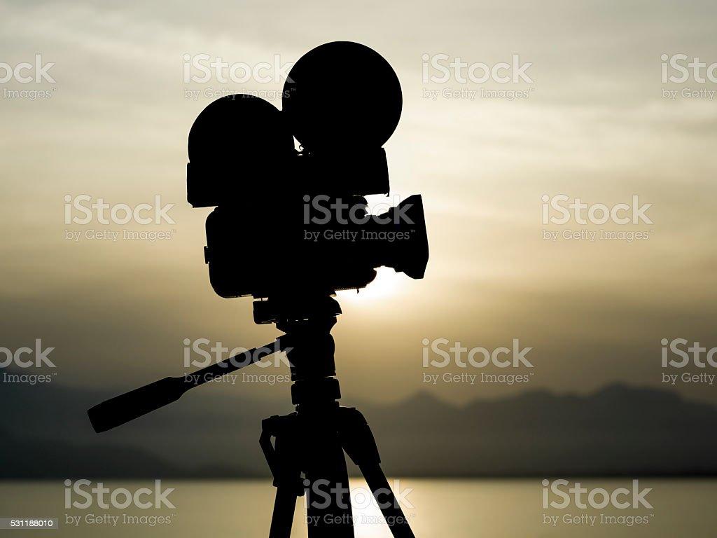 Silhouette Of Video Camera On Tripod stock photo