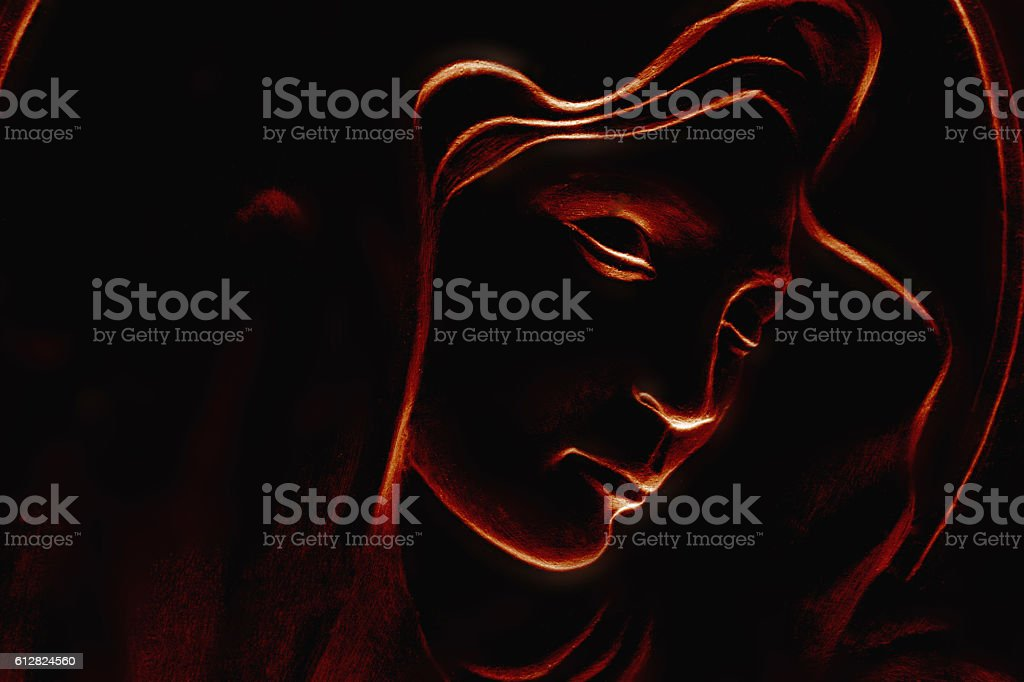 silhouette of Virgin Mary on black background stock photo