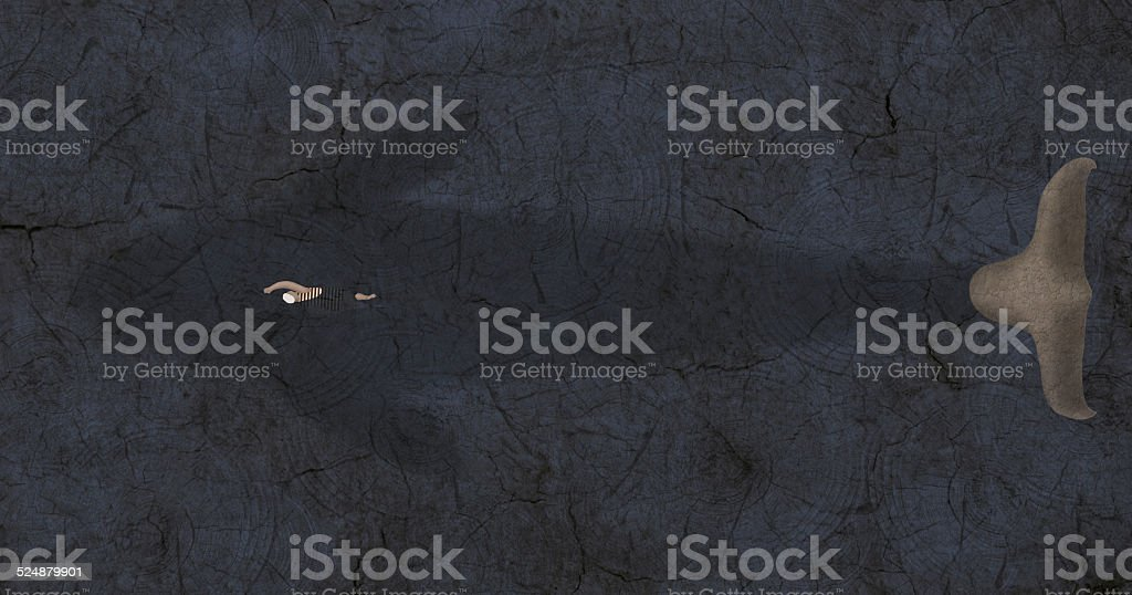 Silhouette of whale with swimmer stock photo