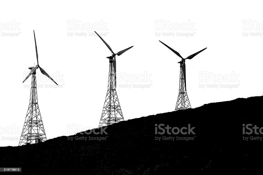 Silhouette of Wind turbine on hill stock photo