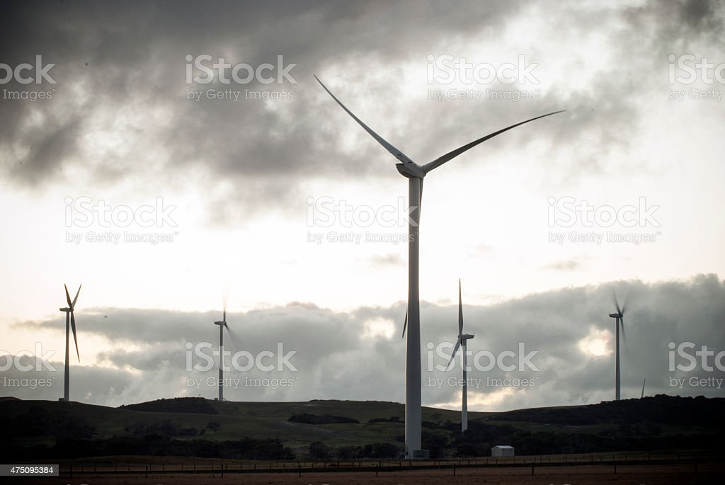silhouette of wind turbines in black and white stock photo