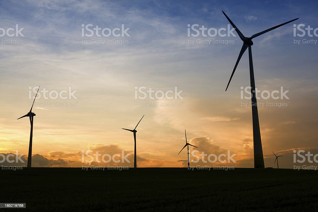 Silhouette of wind turbines royalty-free stock photo