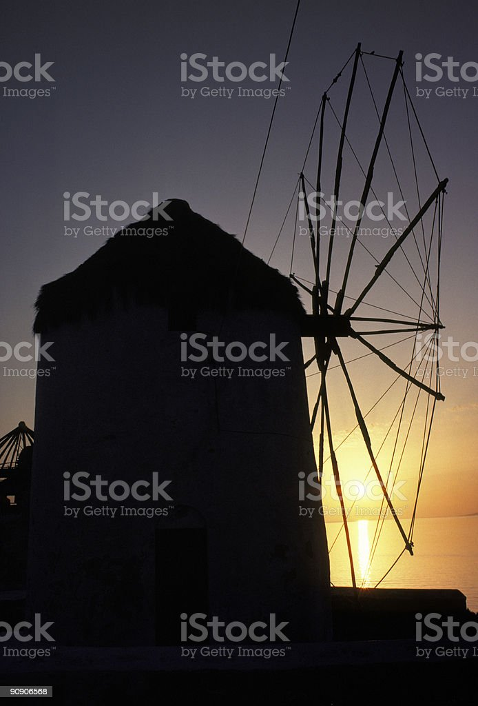 Silhouette Of Windmill In Mykonos, Greece at Sunset royalty-free stock photo