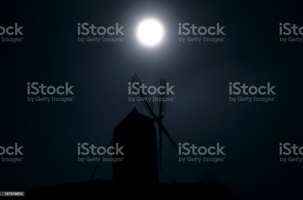 silhouette of windmill under the full moon, la mancha  XXL stock photo