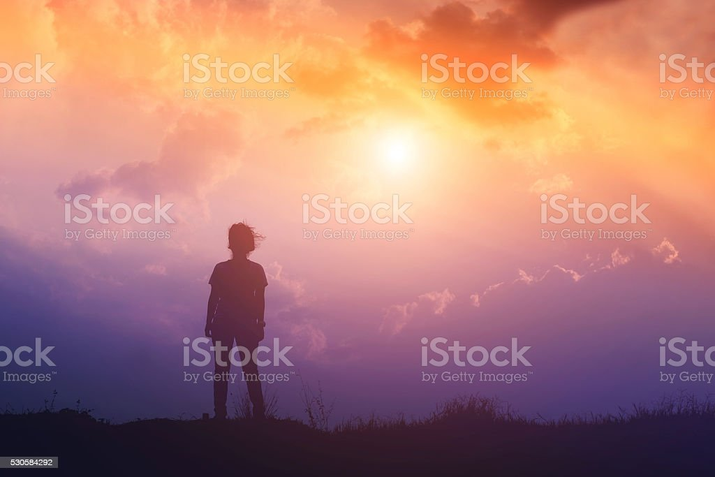 silhouette of woman and sunset time stock photo