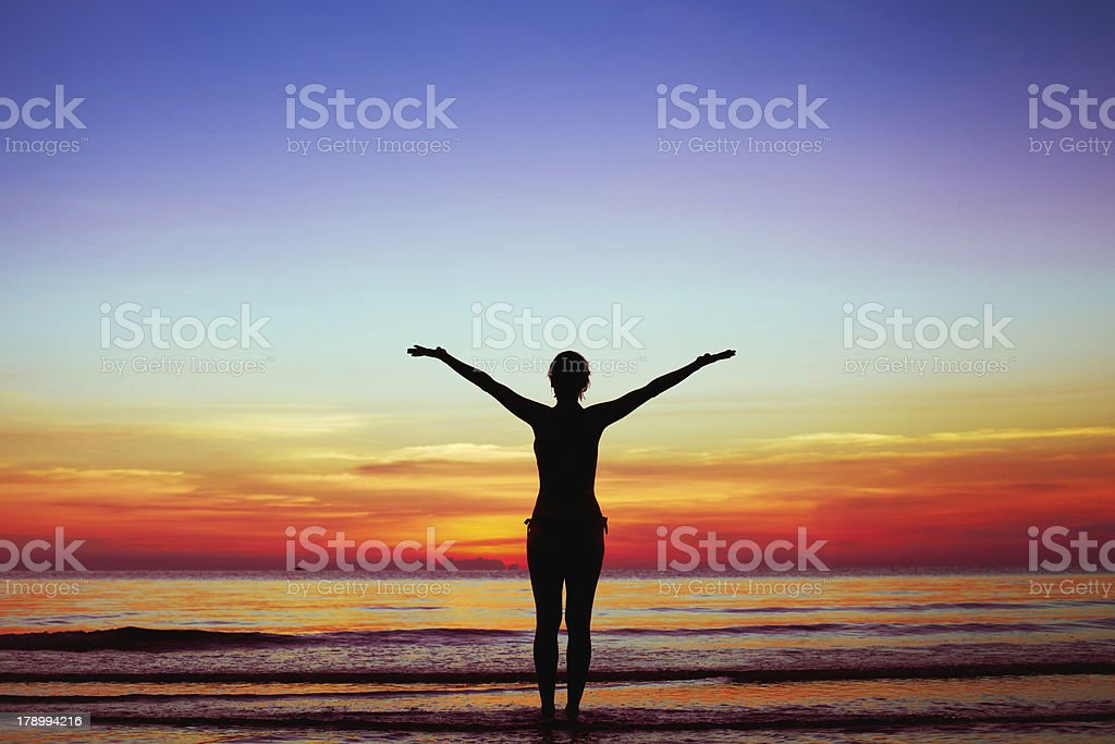 silhouette of woman at sunset royalty-free stock photo