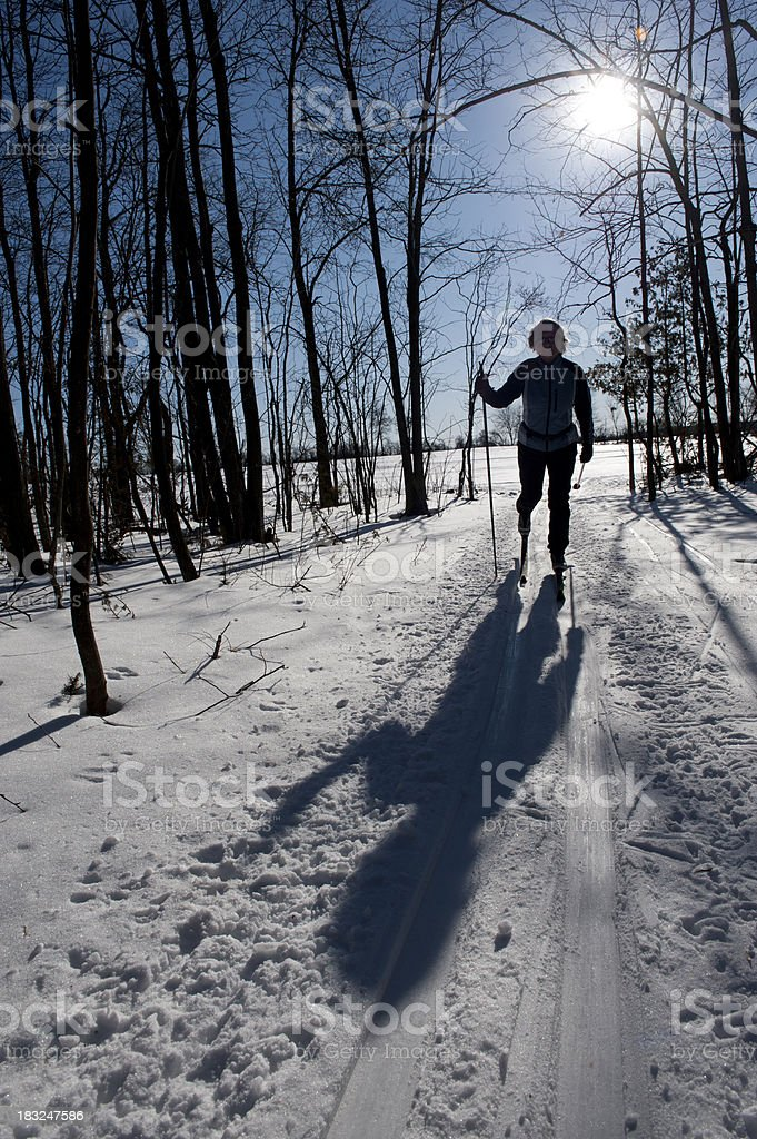Silhouette of woman cross-country skiing, winter sport royalty-free stock photo