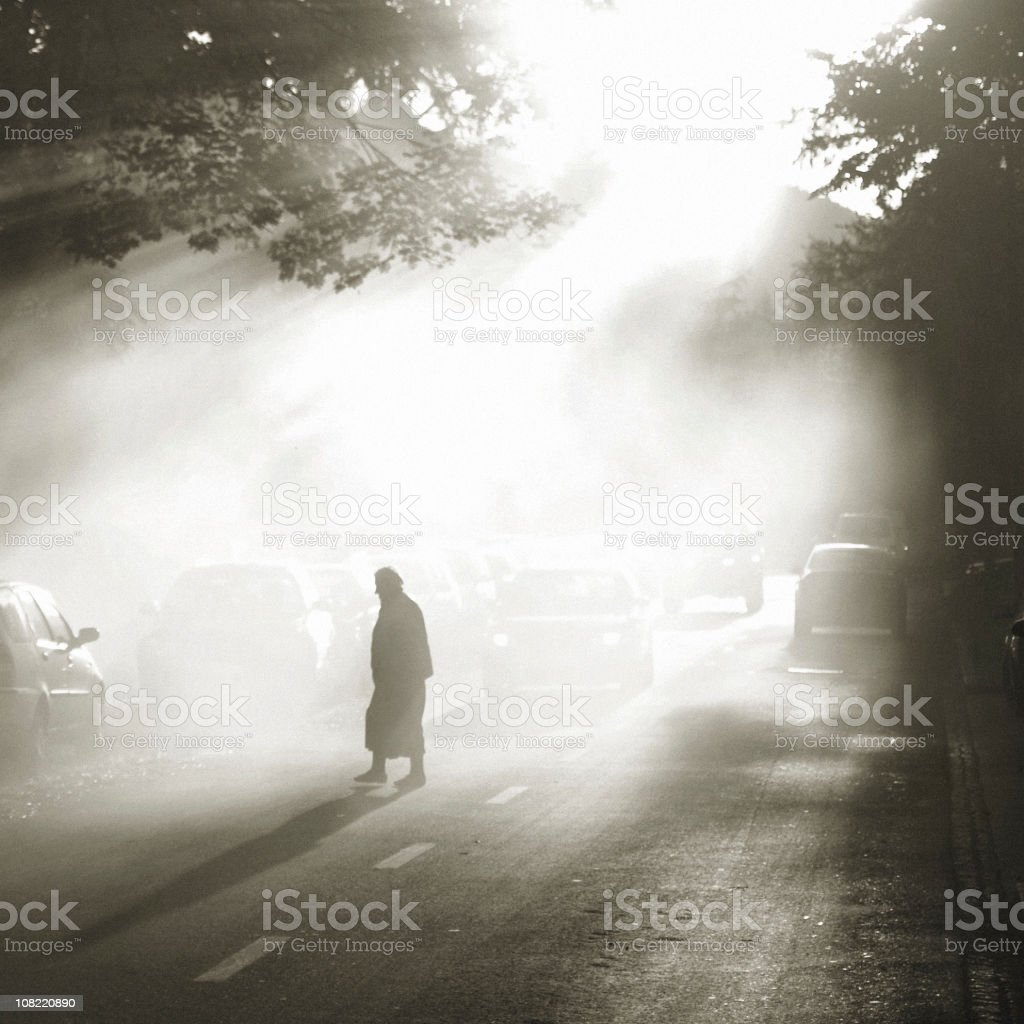 Silhouette of Woman Crossing Street royalty-free stock photo