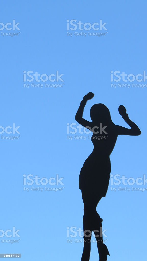 silhouette of woman dancing stock photo