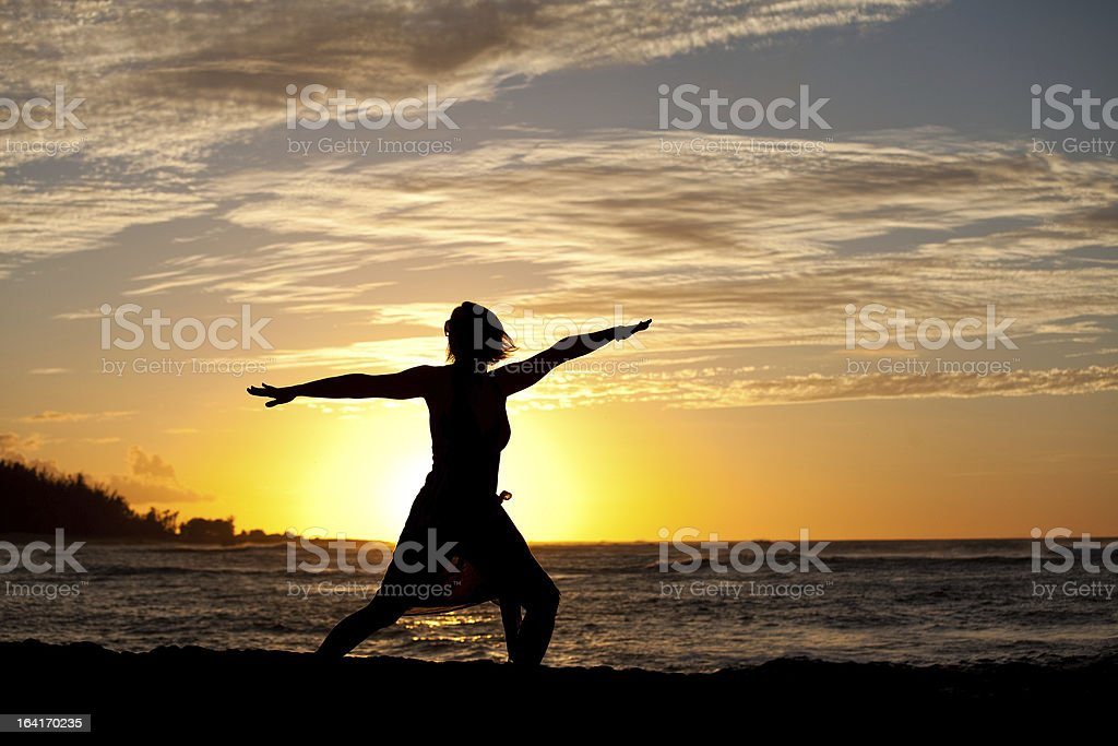 Silhouette of Woman Doing Yoga Beside Ocean royalty-free stock photo