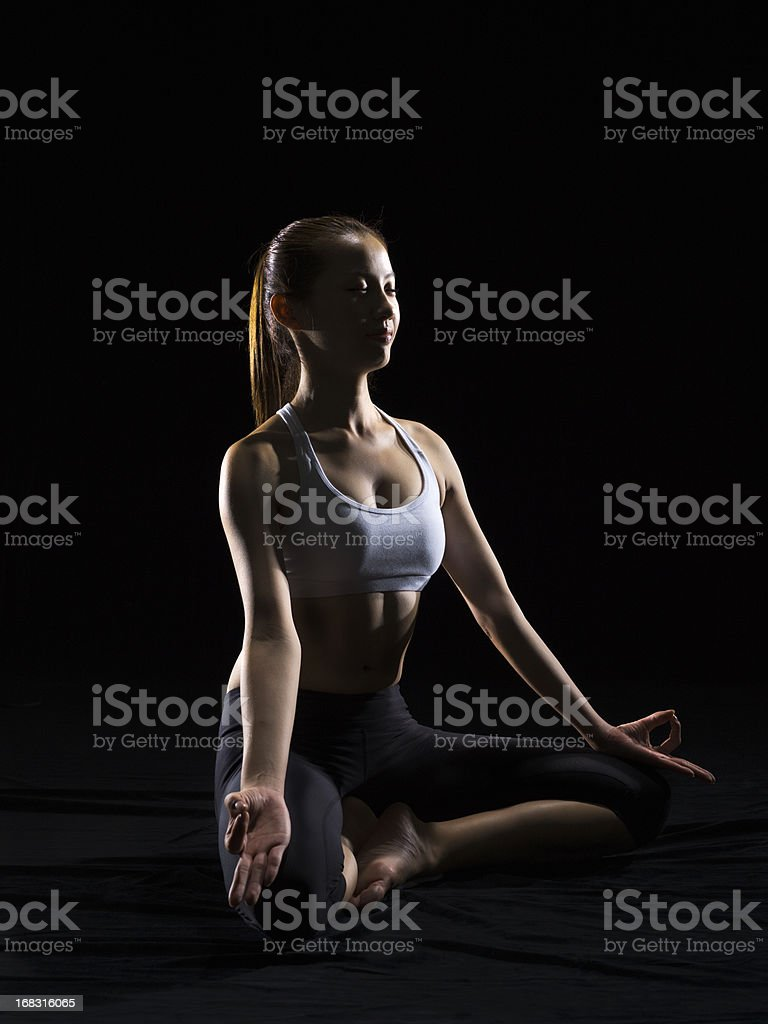 Silhouette of woman doing yoga royalty-free stock photo