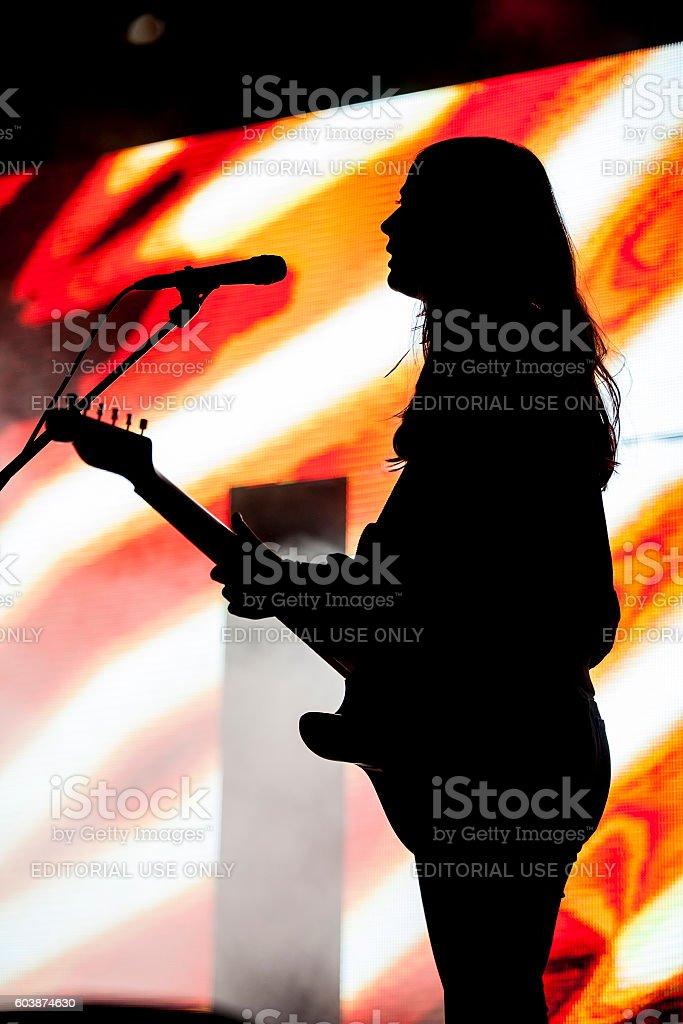 silhouette of woman guitar player from Ost & Kjex, Traenafestival stock photo