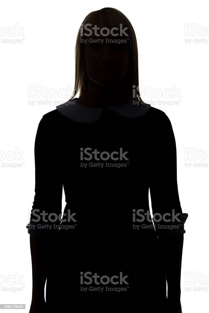 Silhouette of woman in dress stock photo