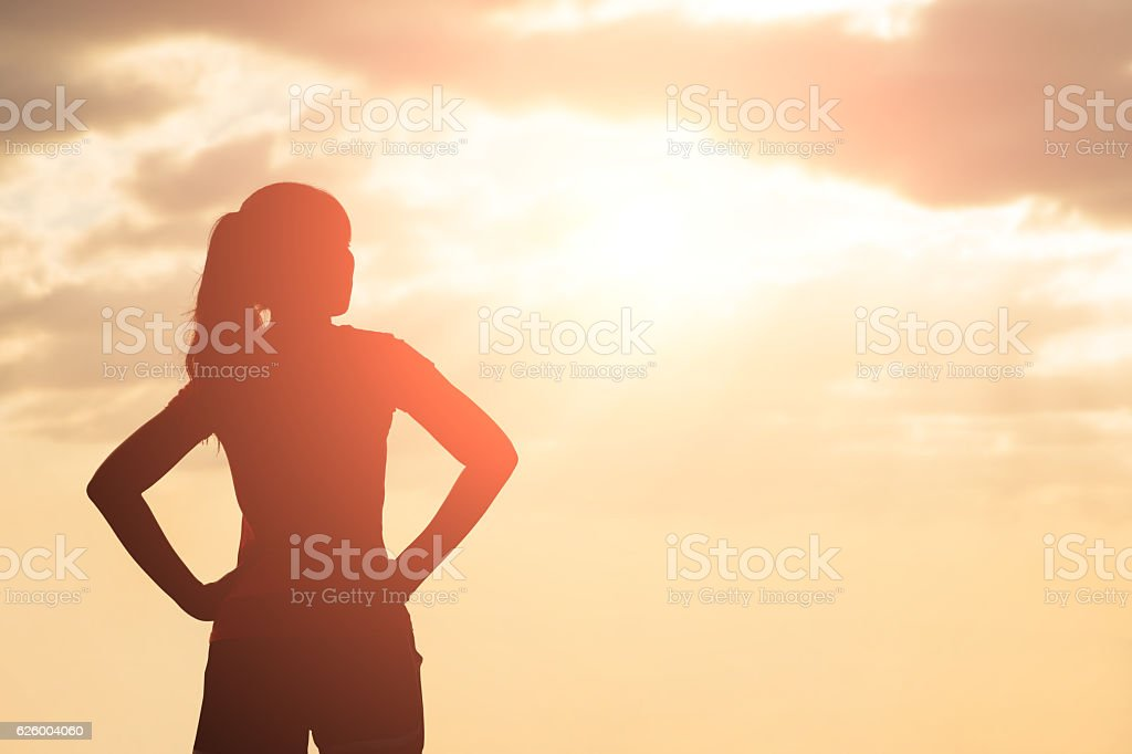 silhouette of woman look stock photo