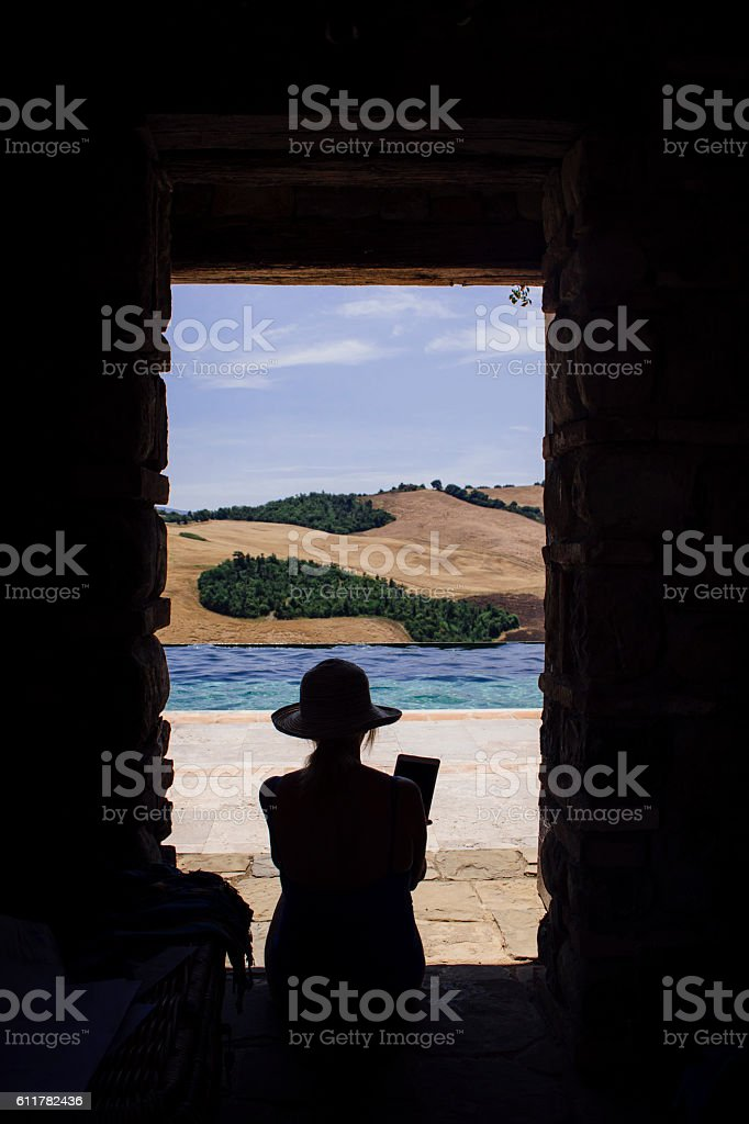 Silhouette of Woman on Vacation stock photo