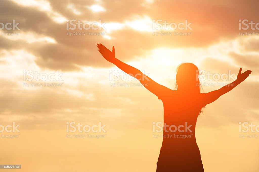 silhouette of woman pray stock photo