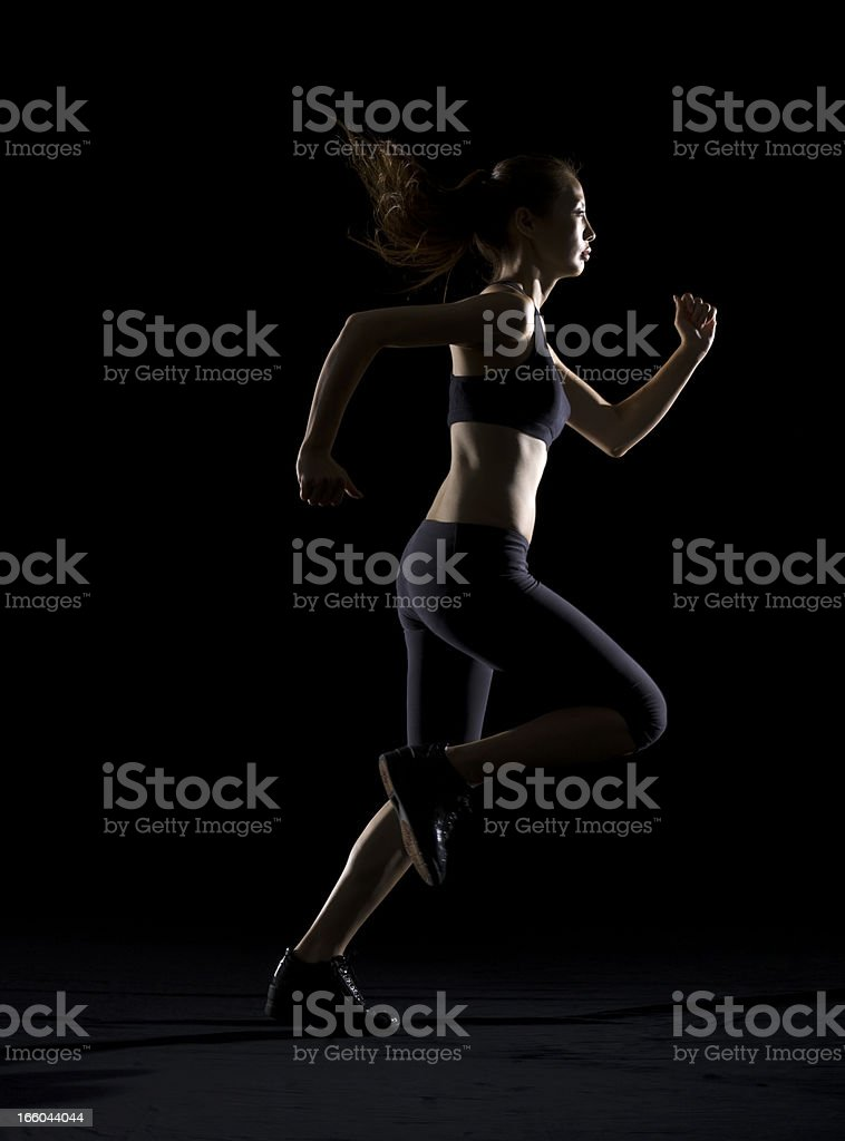 Silhouette of woman running royalty-free stock photo