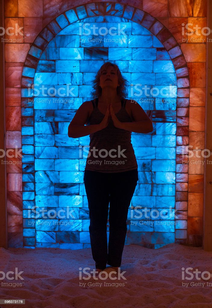 Silhouette of woman standing in salt cave stock photo