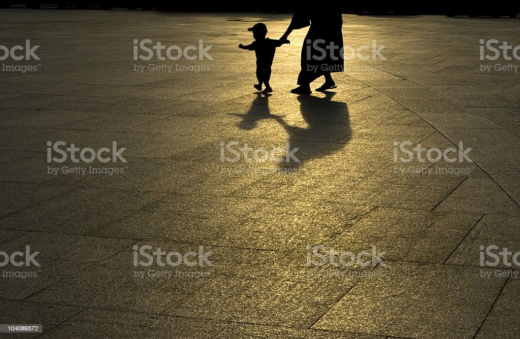 Silhouette of woman with young boy outdoors royalty-free stock photo