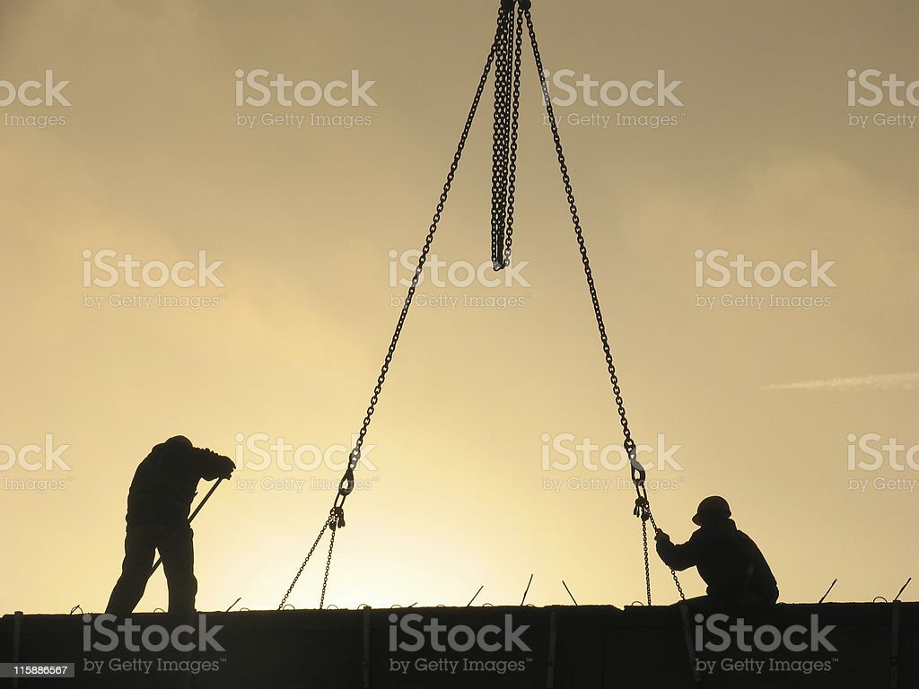 Silhouette of workers with chains royalty-free stock photo