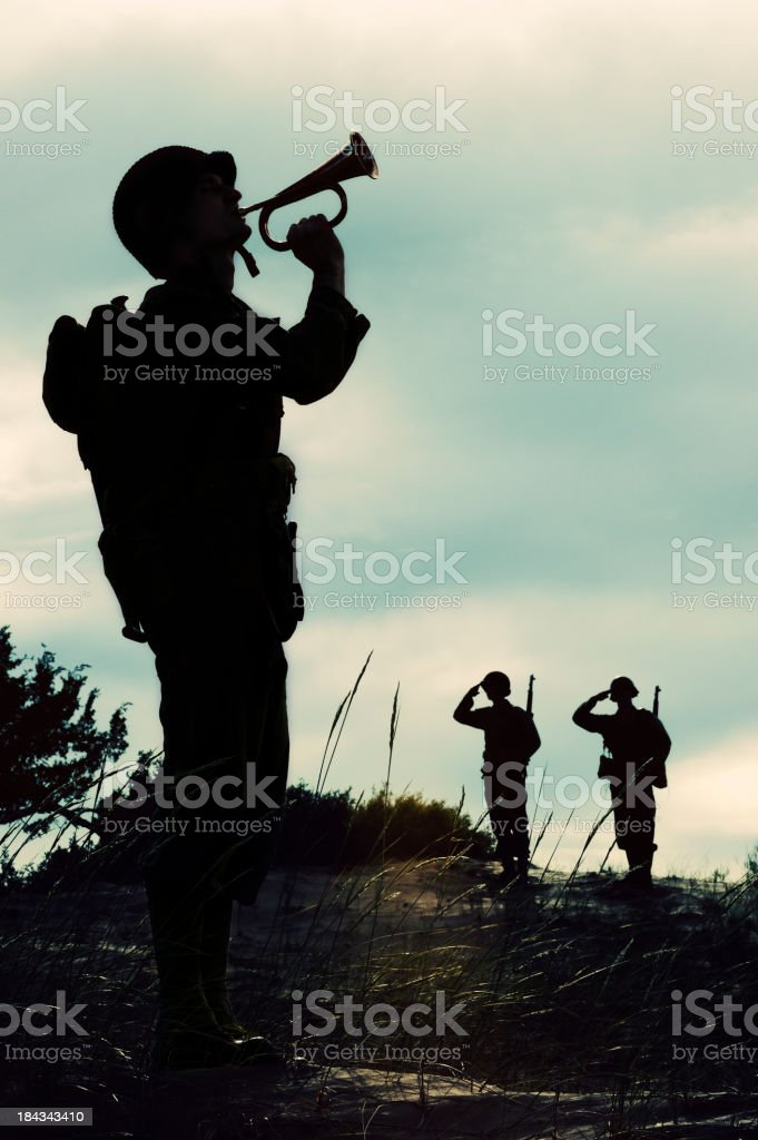 Silhouette of WWII  Soldier Playing Taps  At  Days  End stock photo