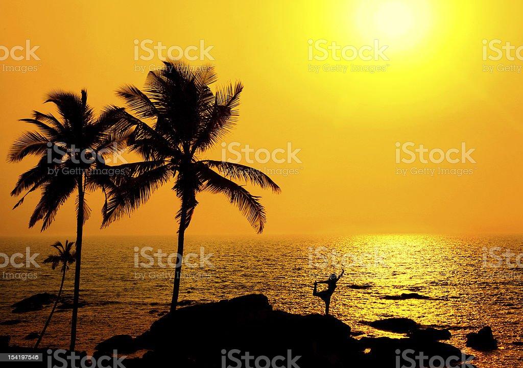 Silhouette of Yoga natarajasana at sunset royalty-free stock photo
