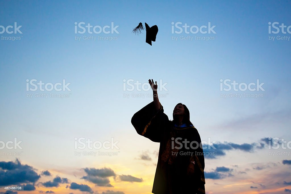 Silhouette Of Young Female Student Celebrating Graduation stock photo