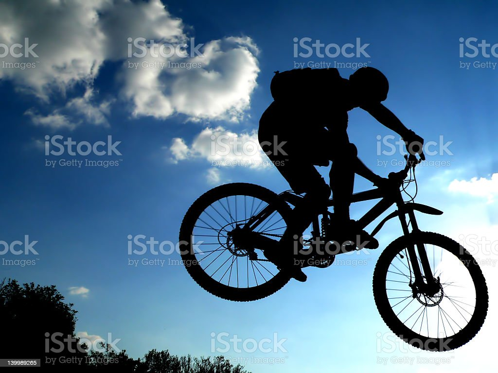 Silhouette of young male performing BMX jumps royalty-free stock photo