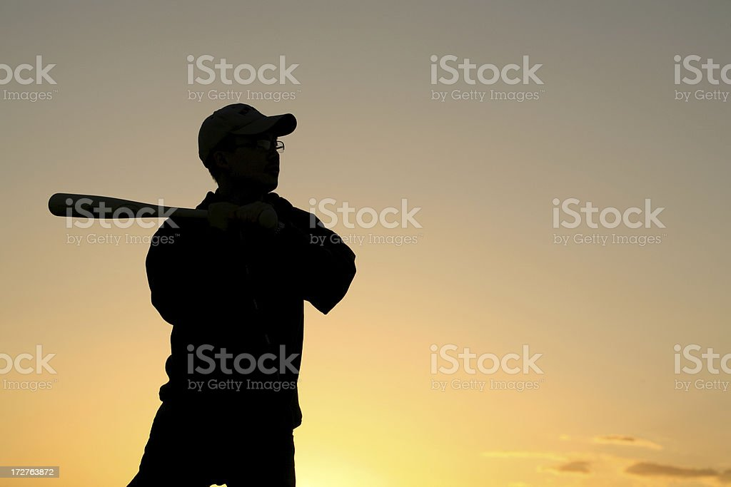 silhouette of young man holding baseball bat royalty-free stock photo