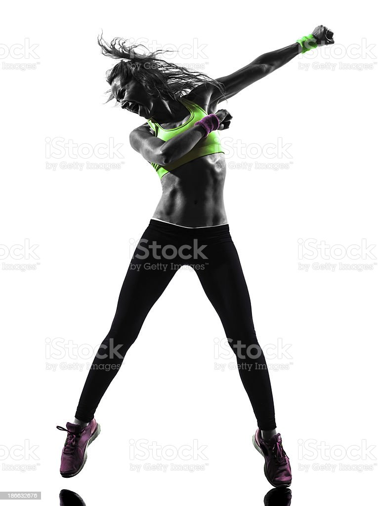 Silhouette of young woman dancing stock photo