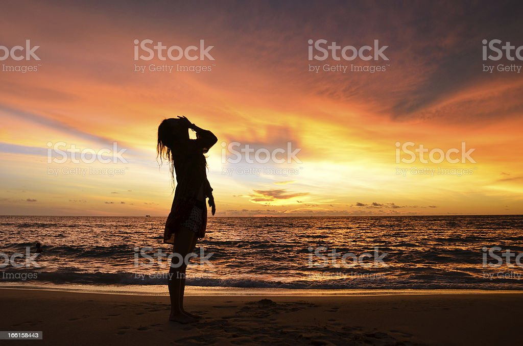 silhouette of young woman portrait by the sea when sunset royalty-free stock photo