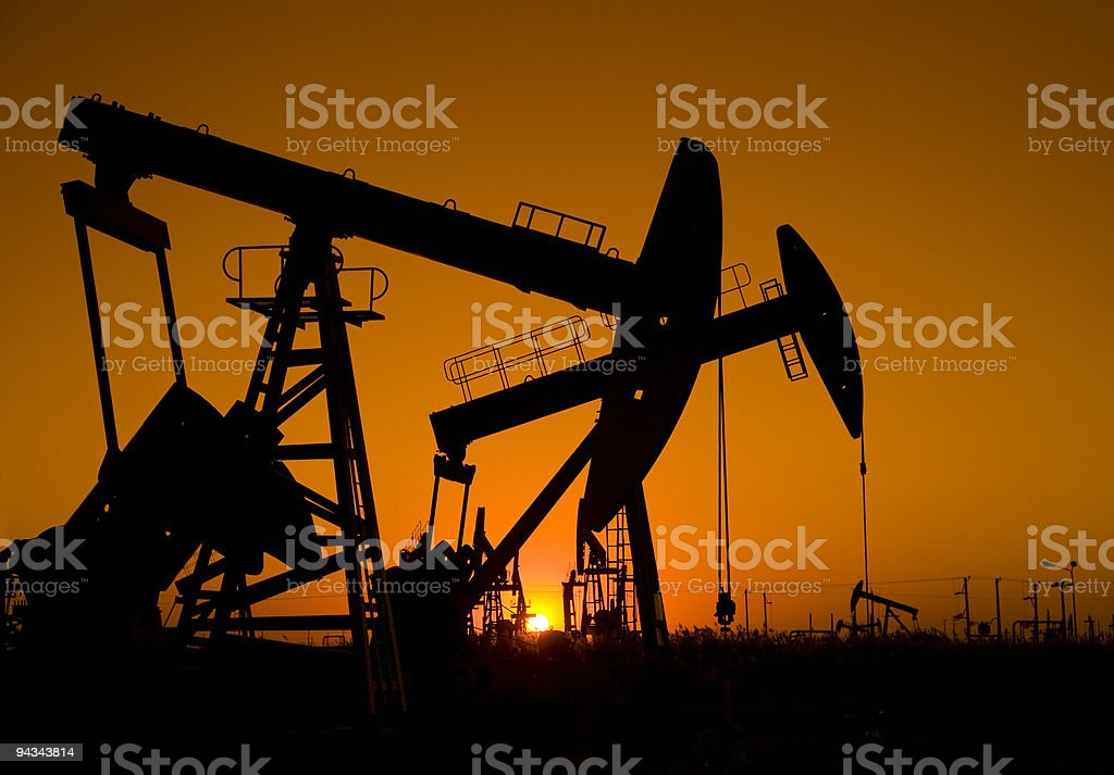 Silhouette oil pumpjack royalty-free stock photo