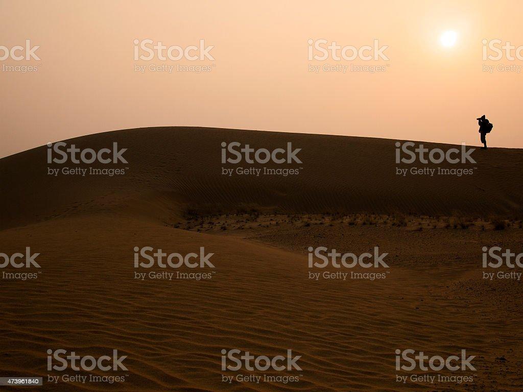 Silhouette photographer at Thar Desert in sunset time stock photo