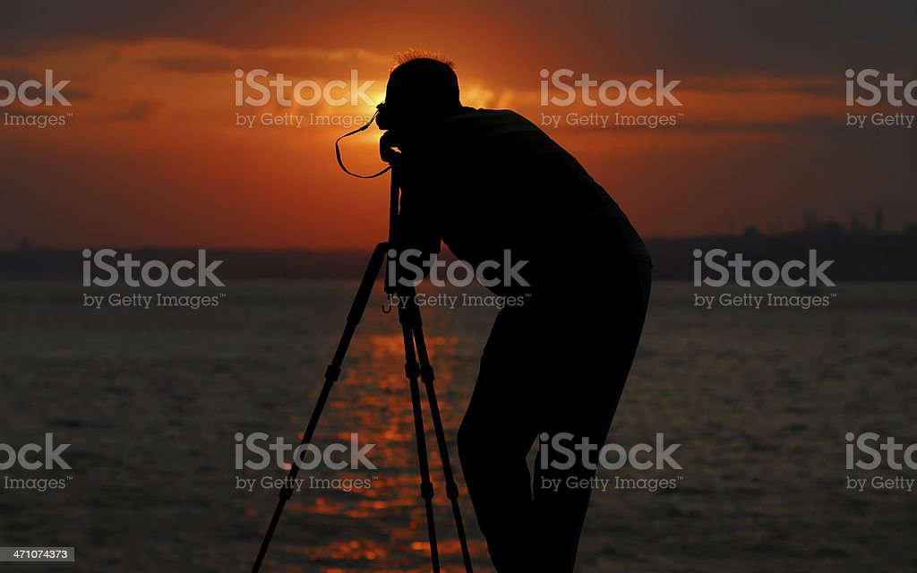 silhouette photographer focusing the sunset royalty-free stock photo