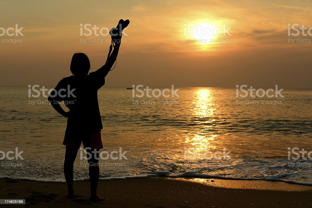 Silhouette photographer's woman at the beach royalty-free stock photo