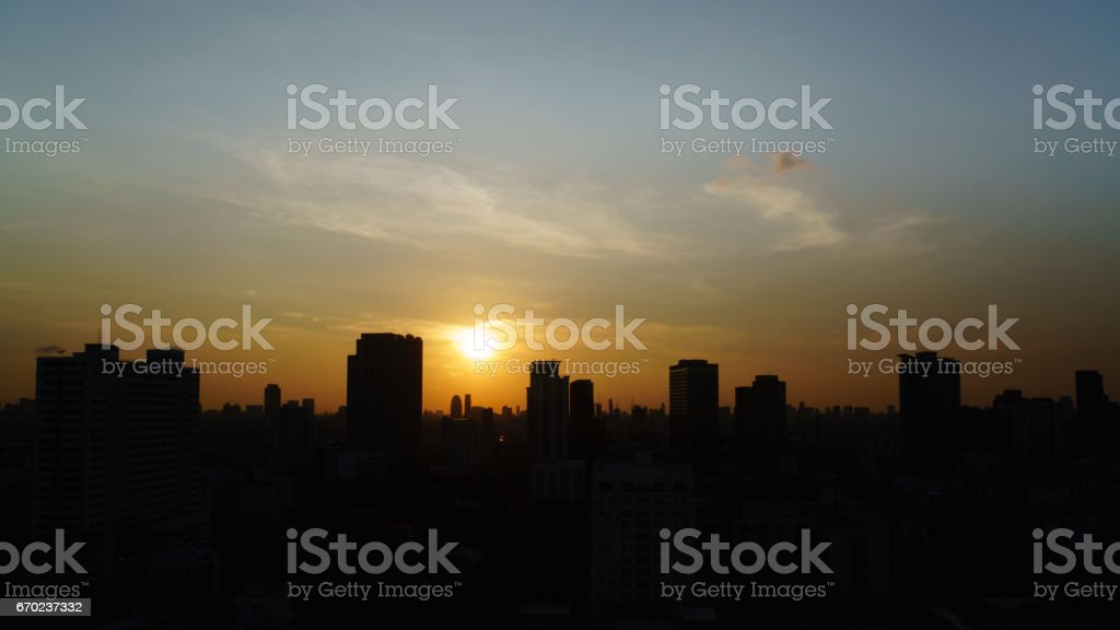 silhouette photography sunset in Bangkok town Thailand stock photo