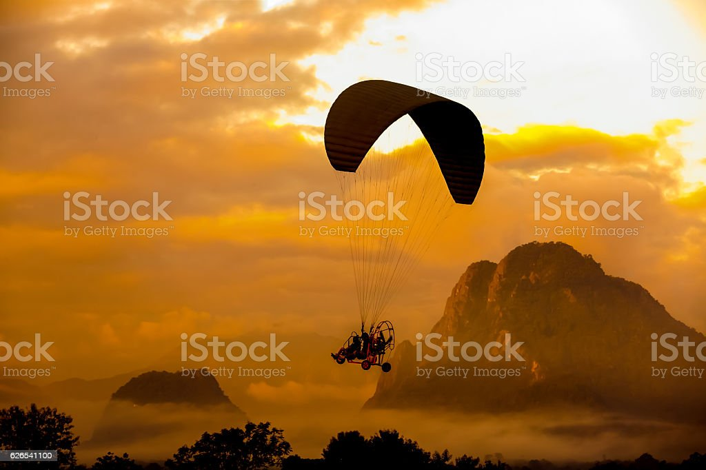 Silhouette player Paramotor stock photo