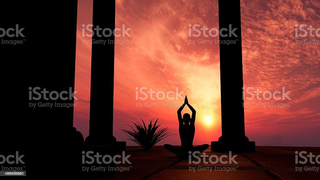 Silhouette practicing yoga stock photo