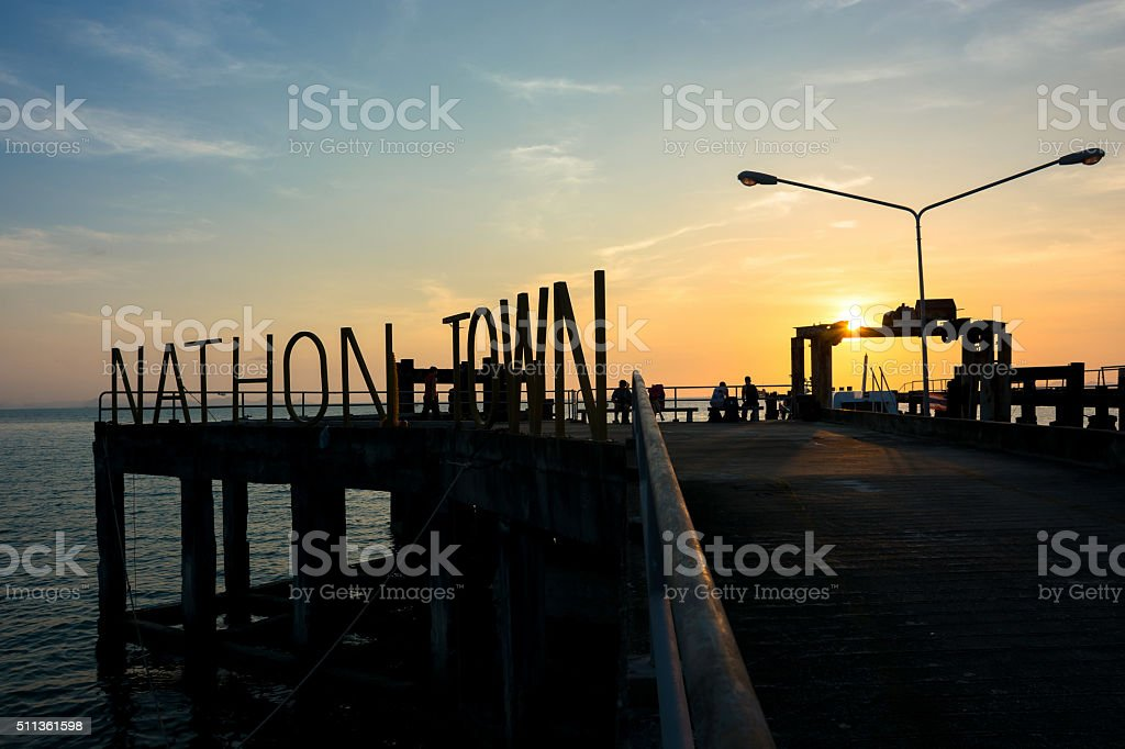 Silhouette public pier with sunset sky in the evening time stock photo