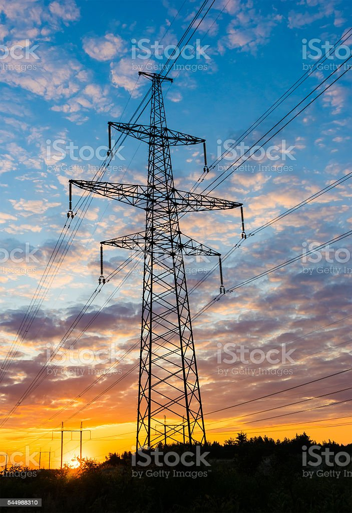 Silhouette pylons against the background of a beautiful sunset stock photo