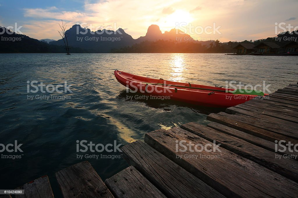 Silhouette scenery during sunset with kayak,canoe stock photo