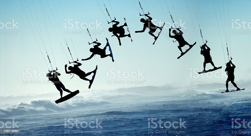 Silhouette Sequence of Surfing Kite Boarder Jumping stock photo