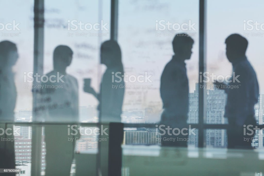 Silhouette shadows of business team meeting in office stock photo