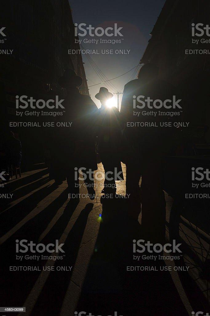 Silhouette Shadows Tibetan Barkhor Lhasa royalty-free stock photo