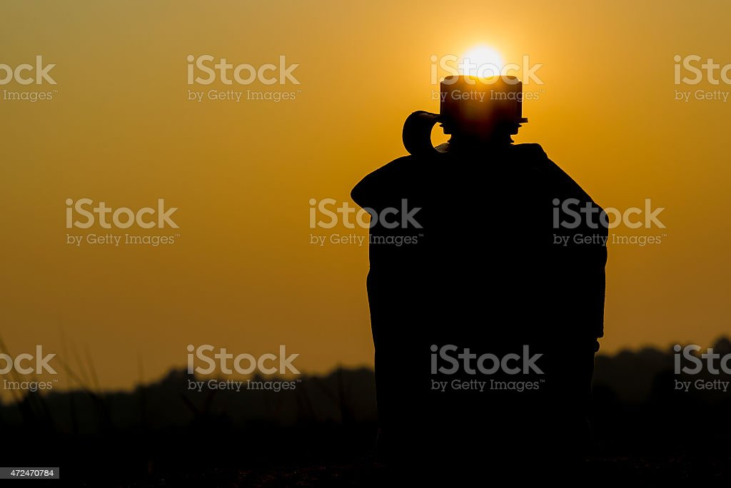 Silhouette shot of Army water canteen stock photo