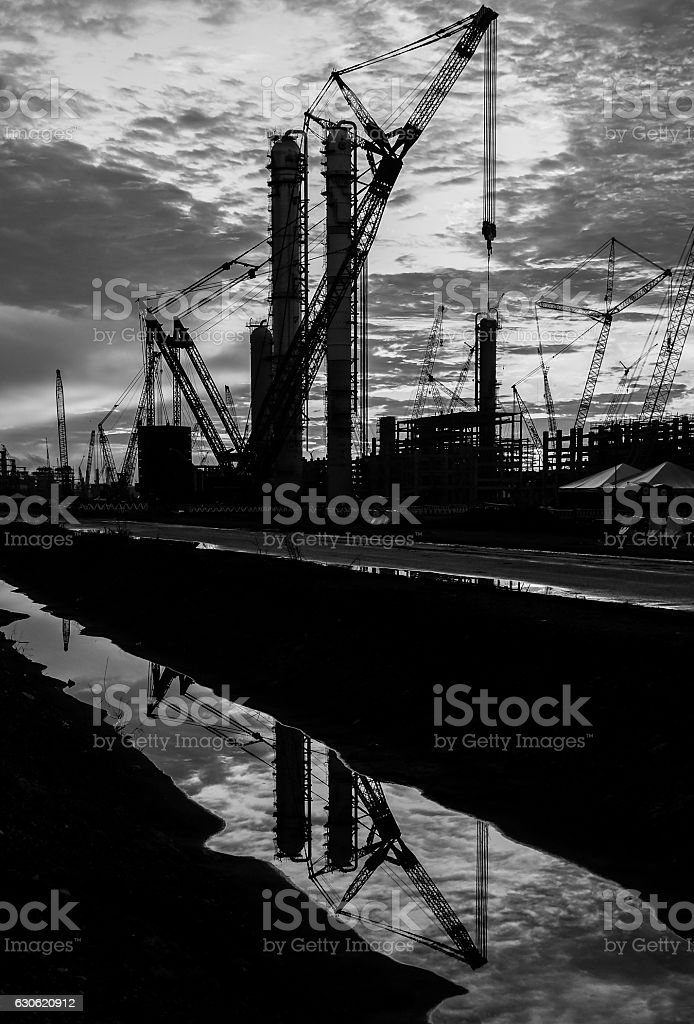 Silhouette shot of construction sites with multiple cranes. stock photo