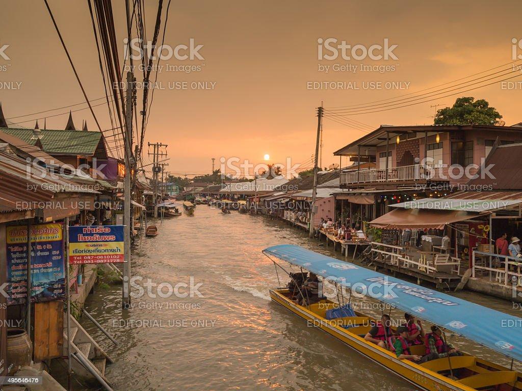 Silhouette twilight sunset at Amphawa Floating Market stock photo