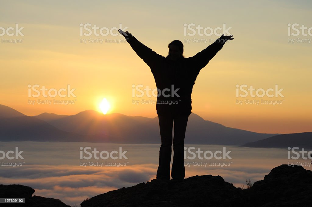 silhouette up hands in mountains royalty-free stock photo