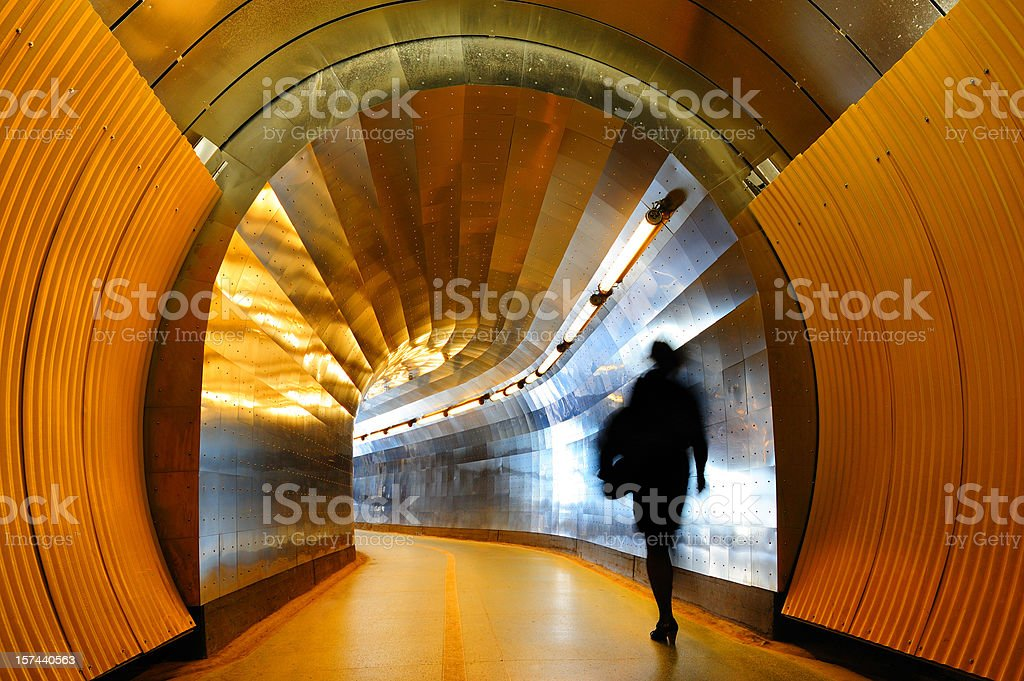 Silhouette walking against light at the end of tunnel royalty-free stock photo