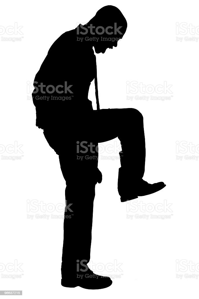Silhouette With Clipping Path of Angry Man Stomping stock photo